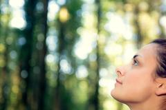 Stock Photo of Young natural woman witting in a forest