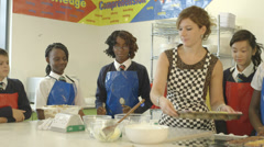 Stock Video Footage of School children and teacher in catering