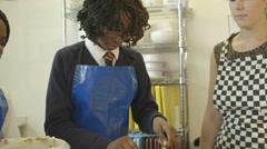 Schoolgirls and teacher in catering Stock Footage