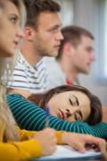 Brunette student falling asleep Stock Photos