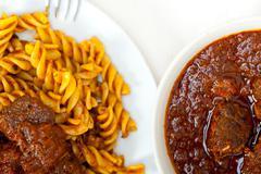 Fusilli pasta with neapolitan style ragu meat sauce Stock Photos