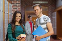 Two happy students looking at camera Stock Photos