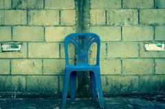 center blue chair on concrete block background - stock photo