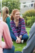 Stock Photo of Smiling students taking a break outside on campus
