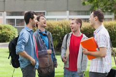 Stock Photo of Happy young students laughing together outside on campus