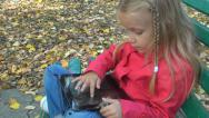 Stock Video Footage of Child Playing on Tablet, Ipad, Little Girl and Touchscreen Device on Bench, Park
