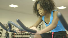 Young girl in gymnasium - stock footage