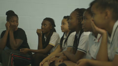 Girl players hand raised while answering - stock footage