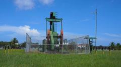 Oil pump jack in work. Oil industry in Seria, Brunei Darussalam Stock Footage