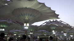 Fast-forwarded footage of canopies opening during sunrise at Nabawi Mosque Stock Footage