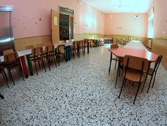 In the refectory of the nursery school with many chairs Stock Photos