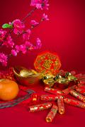 chinese new year decoration plum blossom and gold bullion symbol of luck, chi - stock photo