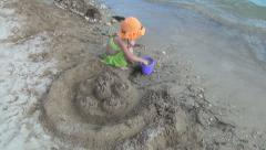 Child Playing with Toys and Sand Castle on Beach, Girl on Coastline, Children Stock Footage