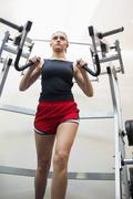Determined brunette training her arms - stock photo