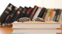 Eyeglasses and books Stock Footage