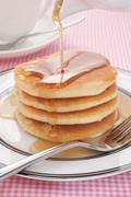 Pancakes and maple syrup Stock Photos