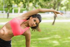 Stock Photo of Toned woman doing stretching exercise in park