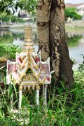 Shrine of the household god beside tree. Stock Photos