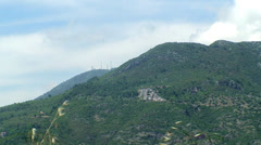 Hills Static Wide Panorama, Buildinds, Antennas And Mountain Road Stock Footage
