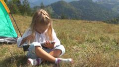 Child, Girl Playing on Tablet, Ipad by Tent in Mountains, Camping, Kids in Trip Stock Footage