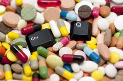 Ctrl and Q keys among drugs (Quit system, quit drugs) Stock Photos
