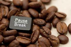 Pause, break key among coffee beans Stock Photos