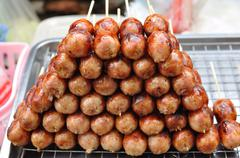 Thai northeast sausages arranged like pyramid layers. Stock Photos