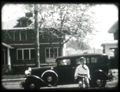 1930s Boy Ridding Bike (16mm) Stock Footage
