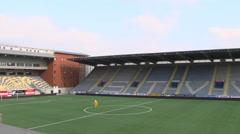 Mascotte STVV running in soccerstation Stayen Stock Footage