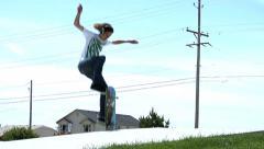 Skateboarder does kickflip at skate park - stock footage