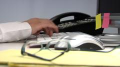 Timelapse shot of hands working at desk Stock Footage
