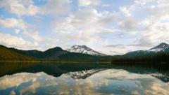 Timelapse panning shot of Mountains and Lake Stock Footage