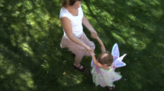 Mother and daugher spinning arround Stock Footage