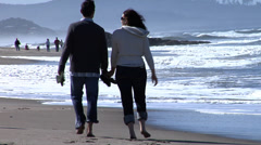 Couple at beach kiss - stock footage