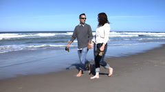 Couple walking on beach Stock Footage