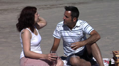 Couple drinking wine at the beach - stock footage