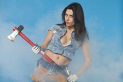 Sexy brunette with an axe in her hand Stock Photos