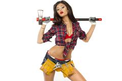 sexy brunette with an ax in his hand - stock photo
