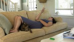 Woman listening to mp3 player in living room - stock footage