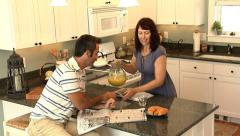 Couple in kitchen having breakfast - stock footage