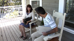 Couple sitting on porch together Stock Footage