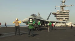 F-18 Hornet prepares for launch on the USS Harry S. Truman Stock Footage
