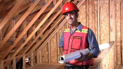 Construction worker holding plans Stock Footage