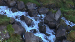 Water flows over rocks Stock Footage
