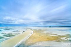 low tide in mont saint michel bay. normandy, france. - stock photo