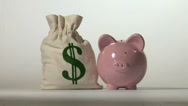 Stock Video Footage of Piggy bank and falling money