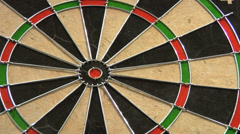 Dart hitting dart board - stock footage