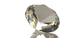 Glass diamond on white surface Stock Footage