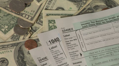 Tax forms and money - stock footage