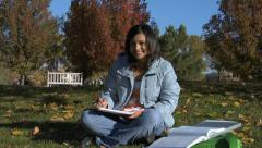 College student studying outdoors - stock footage